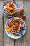 Belgium waffles with strawberry,apricot and maple  Stock Photography