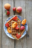 Belgium waffles with strawberry,apricot and maple syrup Royalty Free Stock Photos