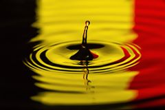 Belgium Water drip close macro flag of country. Belgium Water dripping or water ripples in a pond. waves of rippling flag of country royalty free stock photography