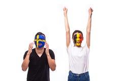 Belgium win, Sweden lose. European football fans concept. Belgium vs Sweden. Football fans of national teams demonstrate emotions: Belgium win, Sweden lose Royalty Free Stock Photo