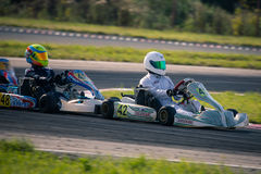 Belgorod, Russia - August 13: unidentified pilots compete on the track at the sports karting series Rotax max Cup RAF Royalty Free Stock Photo