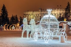 LED light horses with a carriage decoration composition in New Year`s Cathedral Square Belgorod city. Belgorod, Russia - January 8, 2017: LED light horses with Royalty Free Stock Photography