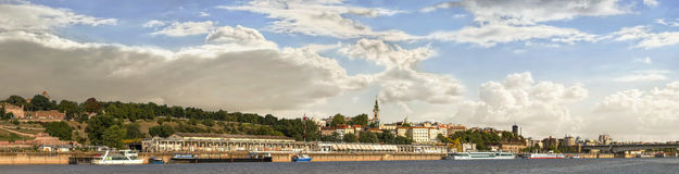Belgrade Cloudy Panorama With Kalemegdan Park And City Downtown Skyline. Panoramic view of Belgrade cloudy skyline with Kalemegdan park, tourist nautical port stock image