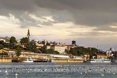 Belgrade Cloudy Waterfront Panorama at Dusk - Tourist Port on Sava River - Belgrade - Serbia. Belgrade downtown cloudy skyline with Tourist nautical port, Old Royalty Free Stock Image