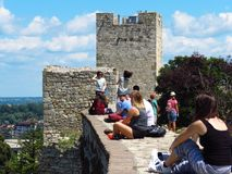 Belgrade fortress. Belgrade, Serbia. July 20, 2018. Foreign tourists resting on the wall and enjoying the view from the Kalemegdan fortress royalty free stock photography