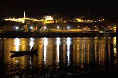 Belgrade at night. Belgrade, Kalemegdan fortes at night with fisherman in boat in front Stock Photo