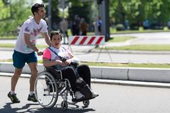 Disabled woman in wheelchair runs in Belgrade marathon royalty free stock images