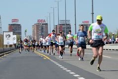 BELGRADE, SERBIA - APRIL 21: A group of marathon competitors dur Stock Photos