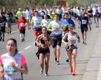 BELGRADE, SERBIA - APRIL 21: A group of marathon competitors dur Royalty Free Stock Images