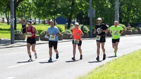 Athletes from many countries, running marathon stock photography