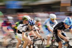 Motion blur panning shot of young bicycle racers competing Stock Images