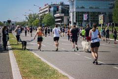 BELGRADE, SERBIA - APRIL 21st, 2018: People running with their d stock photography
