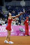 Tennis player Jelena Jankovic serves the ball during a tennis match Royalty Free Stock Images