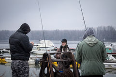 BELGRADE, SERBIA - FEBRUARY 7, 2015: Fishermen fishing on the Danube in Zemun district Stock Photography