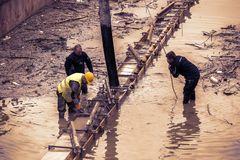 Workers pouring underwater concrete Royalty Free Stock Images