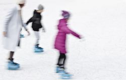 Family ice skating in motion blur Stock Images