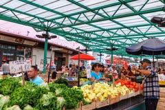 Belgrade, Serbia - 19 July, 2016: Different people at a farmers market Zeleni Venac in Belgrade, Serbia Royalty Free Stock Image