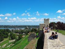Belgrade fortress. Belgrade, Serbia. July 20, 2018. Foreign tourists resting on the wall and enjoying the view from the Kalemegdan fortress stock image