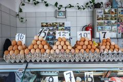 Fresh eggs at the Serbian Zeleni Venac farmer's market. Belgrade, Serbia - 19 July, 2016: fresh eggs in the cortical tray the Serbian Zeleni Venac farmer's Royalty Free Stock Photos