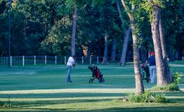 Belgrade, Serbia- June 1, 2019: afternoon recreation at the golf course. Two friends taking recreational tour at the golf course in the afternoon royalty free stock images