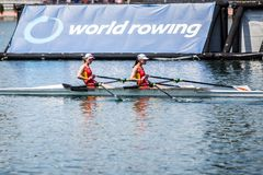 Chinese Switzerland athletes on a World Rowing Cup Competition rowing royalty free stock images