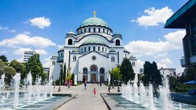 BELGRADE, SERBIA - JUNE 29, 2017: Church of Saint Sava in Belgra. De, Serbia, one of the largest Orthodox churches in the world on a sunny days with playful Royalty Free Stock Photos