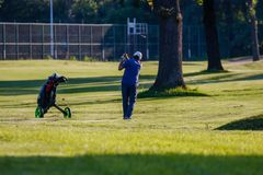 Belgrade, Serbia- June 1, 2019: Senior golfer at the golf course, just hit the ball stock image