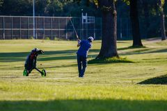 Belgrade, Serbia -June 1, 2019: senior golfer just hit the ball with ball visible in the air. Senior golfer on a recreational tour, golfer hitting the ball, golf royalty free stock photos