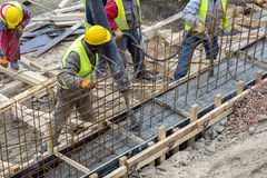 Builders working on concreting formwork for the foundation Royalty Free Stock Photography