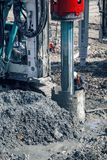 Drilling rig making for deep foundation piles. BELGRADE, SERBIA - MARCH 25, 2017: Drilling rig making for deep foundation piles at construction site,  rotary Stock Photo