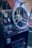 Luxury yacht commands. BELGRADE, SERBIA - MARCH 11, 2017: Luxury yacht commands and wheel. Well equipped dashboard on yacht. Selective focus Stock Images