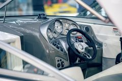 Well equipped dashboard on yacht. BELGRADE, SERBIA - MARCH 11, 2017:  Well equipped dashboard on yacht. Luxury yacht commands and wheel. Selective focus Stock Photo
