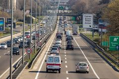 Highway crowded with all sort of vehicles. stock images