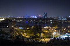 Skyline of New Belgrade Novi Beograd seen by night from the Kalemegdan fortress. BELGRADE, SERBIA - NOVEMBER 8, 2014:The main landmarks of the district, such as royalty free stock photos