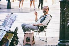 Belgrade Serbien - 19 Juli, 2016: Folket sjunger på den mest berömd shoppinggatan och av de favorit- destinationerna av turister Fotografering för Bildbyråer