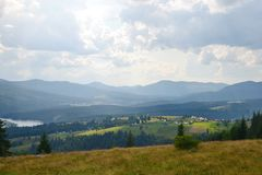 Landscape with the Belis Lake and village in the Apuseni mountains Stock Images
