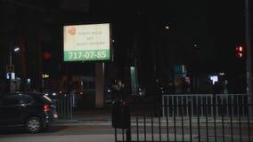 Belichtete Anschlagtafel Werbung von Wahlkampf des Präsidentschaftsanwärters Anatoly Gritsenko Tempel am Sonnenuntergang crosswal stock video