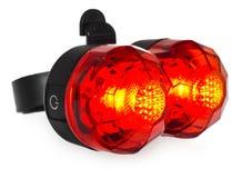 Belichtete hintere Fahrradlampe, Plastik in einer roten Farbe Lizenzfreies Stockfoto