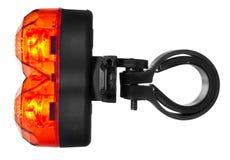 Belichtete hintere Fahrradlampe, Plastik in einer roten Farbe Stockfoto