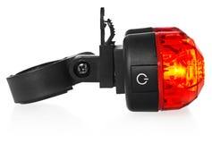 Belichtete hintere Fahrradlampe, Plastik in einer roten Farbe Stockbild
