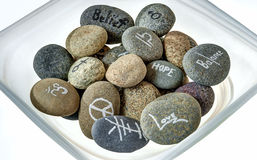 Symbols and Messages Painted on River Stones Stock Photography
