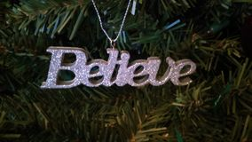 Belief of the Christmas Spirit. Ornament on our green tree this year Stock Image