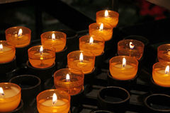 Belief Faith brightened by candle flame Stock Photos