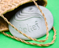 Belief and faith is solid. Solid belief stone getting out of a bag Royalty Free Stock Image