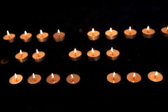 Belief and hope. Burning candles in a church, in the wine village Beilstein at the river Moselle, Germany stock photos