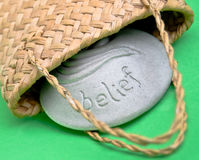 Belief stone. Solid belief stone getting out of a flax bag Royalty Free Stock Photos