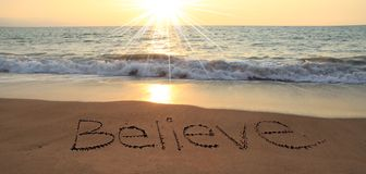 Believe. Written in the sand at the beach Royalty Free Stock Images