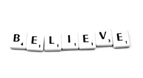 Believe. Plastic game letters forming the word believe Royalty Free Stock Photo