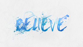 Believe in blue watercolor paints. Believe text handwritten in blue watercolor paints with a splash effect over a textured paper background with copy space Stock Photos