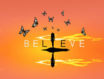 Believe with butterflies sunset Royalty Free Stock Photos
